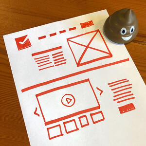 Hand-drawn sketch of a wireframe on paper