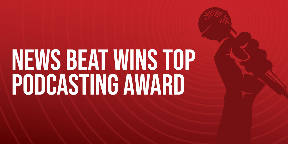 Text that says News Beat Wins Top Podcasting Award on a red gradient background. A hand holding a microphone appears next to the text.