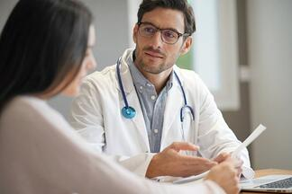 Doctor reviewing digestive health exam results with patient